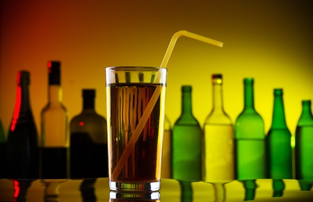 Alcohol cocktail with straw on bar Stock Photo - 13032105