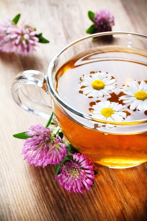 chamomile tea: herbal tea with clover and chamomile Stock Photo