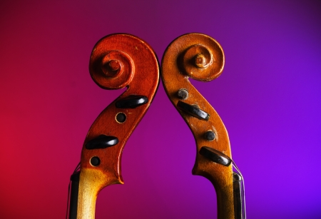 Two vintage violin scrolls photo