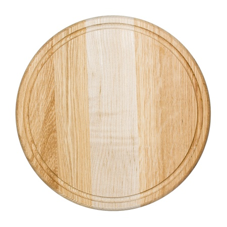 Clean oak cutting board isolated on white photo