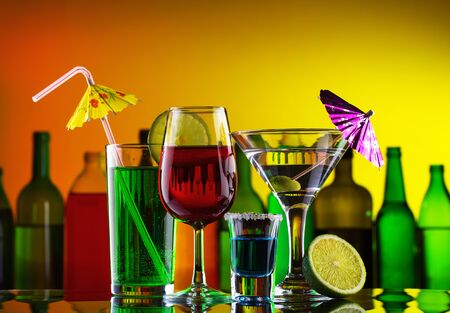 Different alcohol drinks and cocktails on bar Stock Photo - 14967621