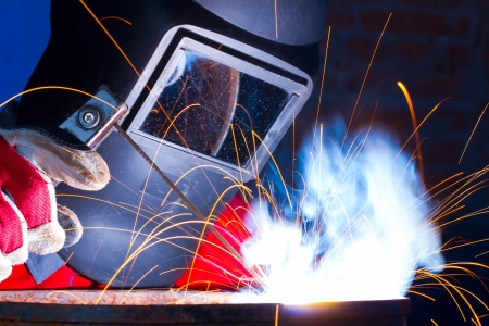 welding metal: Working welder Stock Photo