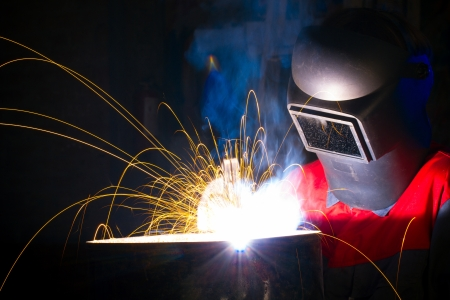 welding worker: Welding with sparks Stock Photo
