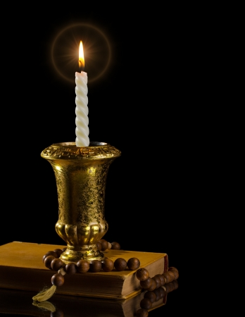 candelabrum: Candle with rosary and antique book