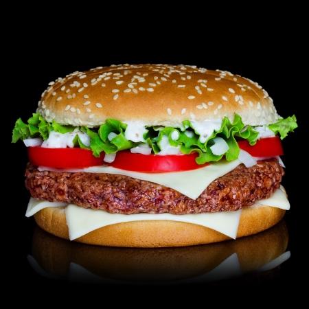 Big hamburger isolated on black backgound with reflection photo
