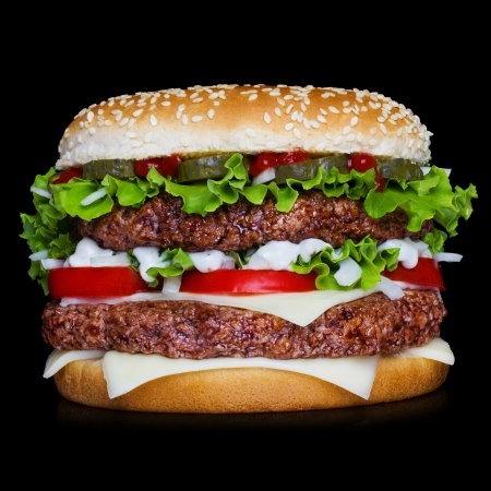 Big hamburger isolated on black backgound with reflection Imagens