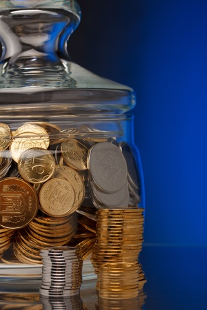 Glass with coins close up Stock Photo - 15795595