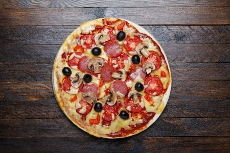 pepperoni: hot pizza on wooden table