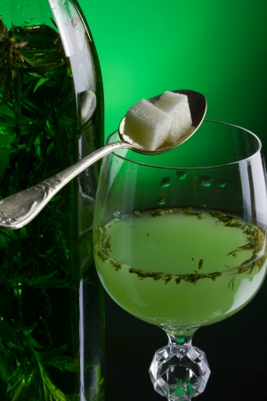Absinthe with sugar close-up