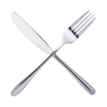 cuchillo de cocina: Cuchillo y tenedor cruzados, aislados en fondo blanco Foto de archivo