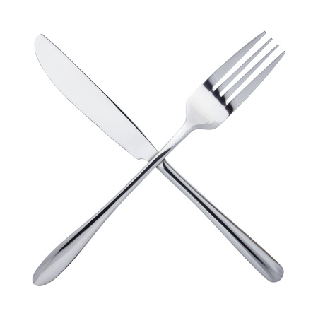 knife and fork: Knife and fork crossed, isolated on white background Stock Photo