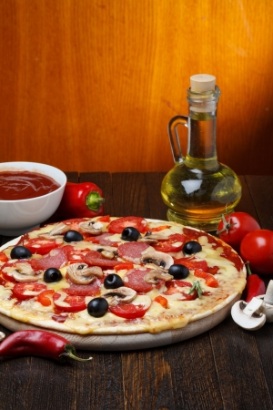hot pizza with ingredients photo