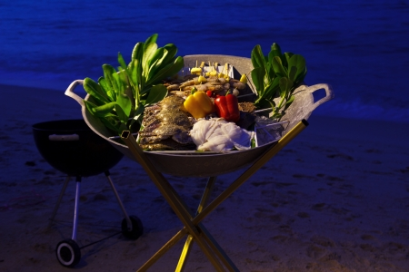 Beach seafood barbecue ingredients at sunset photo