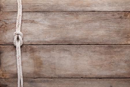 trompo de madera: Resistido fondo de la tabla de madera con nudo llano cuerda, vista superior