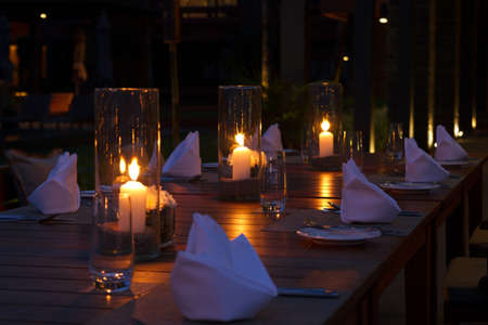 candle light: Outdoor restaurant tables setting