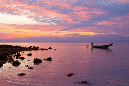 Fisherman boat at sunset photo