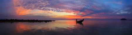 panoramic beach: Sunset over sea with fisherman boat panorama