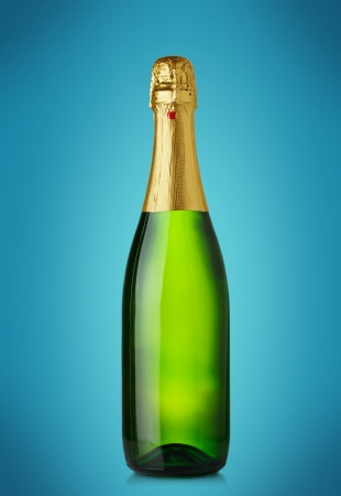 Champagne bottle on blue background photo