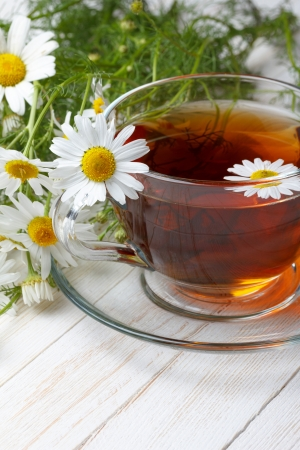 Chamomile tea on wooden table still life photo