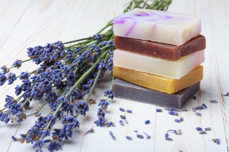 Natural handmade soap stack with lavender on wooden table photo
