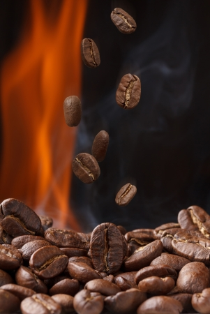 large bean: Roasting coffee with smoke and falling beans