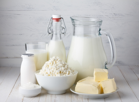 Dairy products, milk, cottage cheese, yogurt, sour cream and butter on wooden table photo