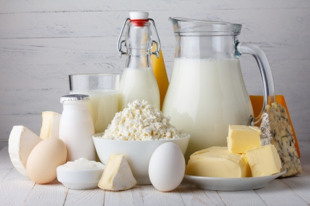Dairy products, milk, cottage cheese, eggs, yogurt, sour cream and butter on wooden table Stock Photo