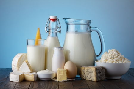 Dairy products on wooden table still life photo