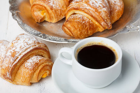 Coffee with fresh croissants photo