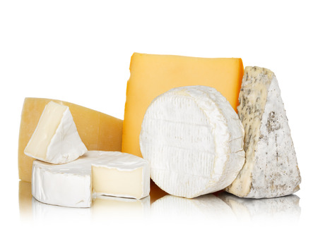 goat cheese: Variety of cheese isolated on white background with reflection