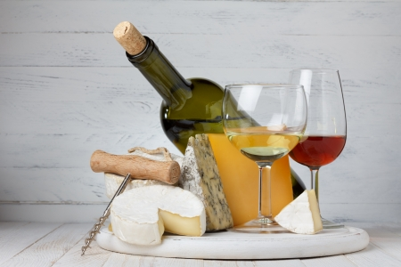 food still: Cheese and wine on wooden table still life