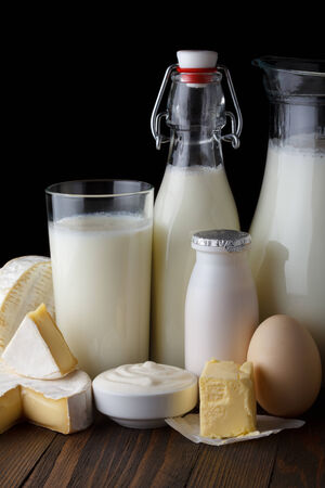 Dairy products on wooden table close-up photo