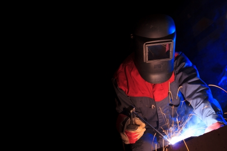 Working welder on black background with copy space Stock Photo - 25052457