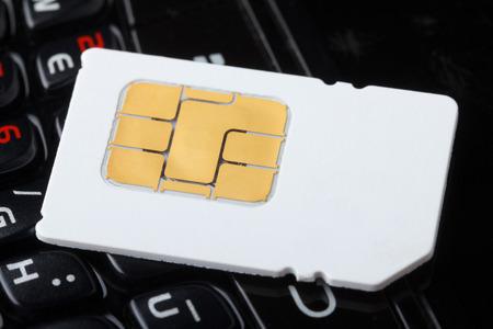 Carte Sim sur le clavier de téléphone portable