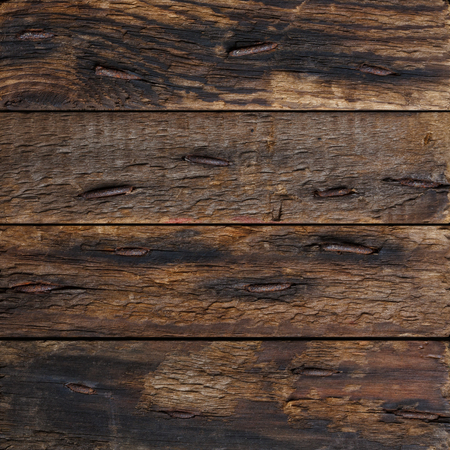 Dark rustic wooden planks with rustic nails  photo