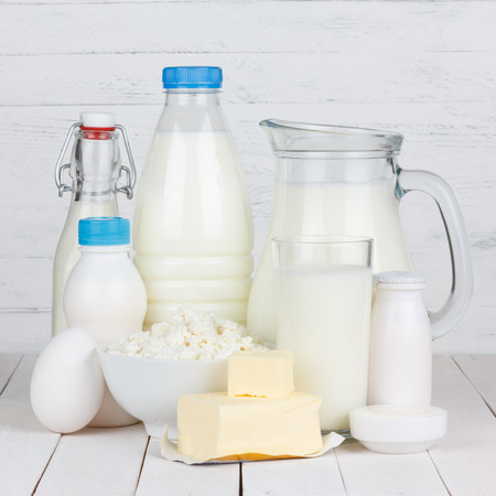 Dairy products on wooden table photo