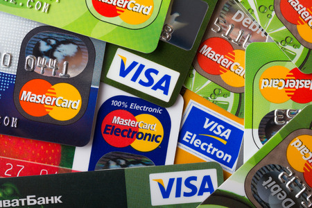 KIEV, UKRAINE - March 28: Pile of credit cards, Visa and MasterCard, credit, debit and electronic, in Kiev, Ukraine, on March 28, 2014.