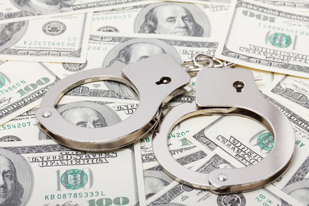 Handcuffs on money photo