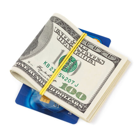 cc: Dollar bills folded and tied with plastic credit cards isolated on white