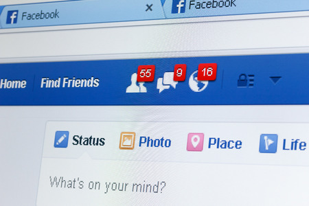 KIEV, UKRAINE - June 8: Facebook web page closeup with notifications of new friends request and messages, and blank status line, in Kiev, Ukraine, on June 8, 2014. Redakční