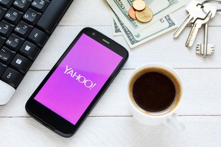 yahoo: KIEV, UKRAINE - June 9: Yahoo service logo on new smartphone, in Kiev, Ukraine, on June 9, 2014.