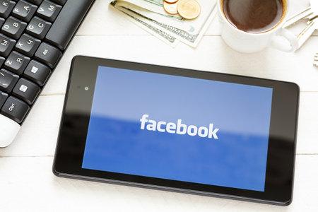 KIEV, UKRAINE - June 9: Facebook social network logo on tablet, in Kiev, Ukraine, on June 9, 2014.