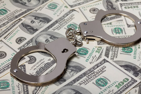 metal handcuffs: Handcuffs on money
