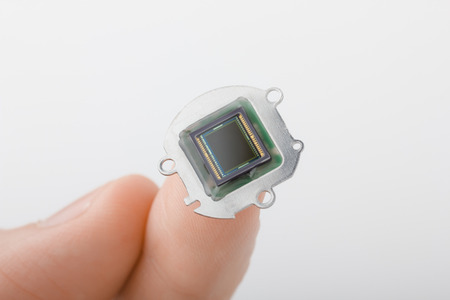 Small digital camera sensor on finger photo