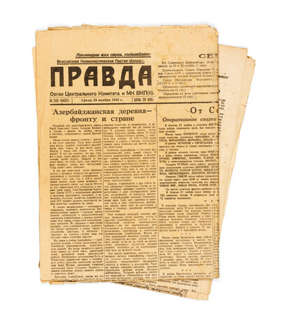 yellowed: KIEV, UKRAINE - May 10, 2014: Vintage USSR newspaper Pravda, dated November 24, 1943, with news of World War II. Editorial
