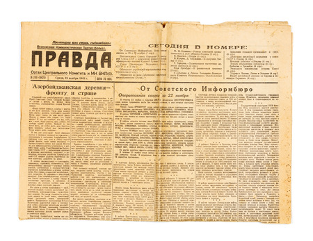 world wars: KIEV, UKRAINE - May 10, 2014: Vintage USSR newspaper Pravda, dated November 24, 1943, with news of World War II. Editorial
