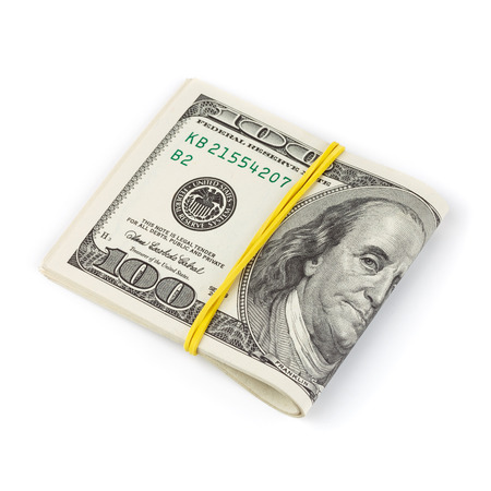 cash money: Billetes de cien dólares doblados y atados con cinta de goma aislados en blanco Foto de archivo