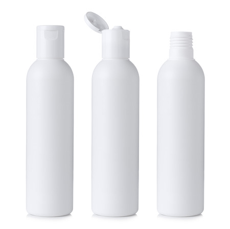 Blank white plastic cosmetics or shampoo bottle closed, open and without cap, isolated on white background