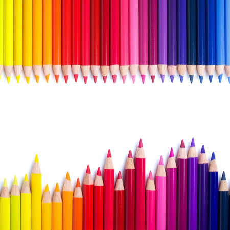 Color pencils in a row, isolated on white with copy space photo