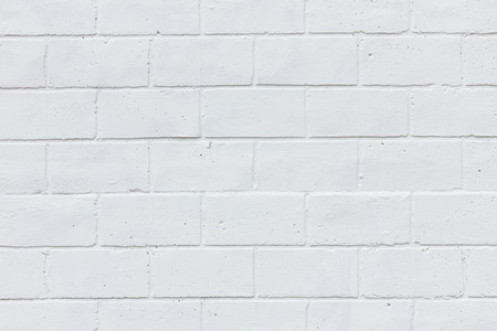 Painted white brick wall texture background photo